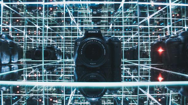 black-canon-camera-on-glass-shelf-274124