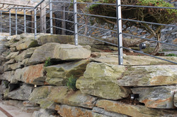 giant stacked dry stone boulder wall