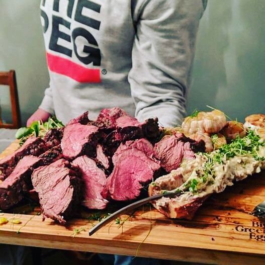 biggreenwinnipegg Repping The Peg With a nice platter of @biggreenegg beef tenderloin, smoked bone marrow butter with some @fresh_forage micro green and some roasted garlic. 💚💚💚