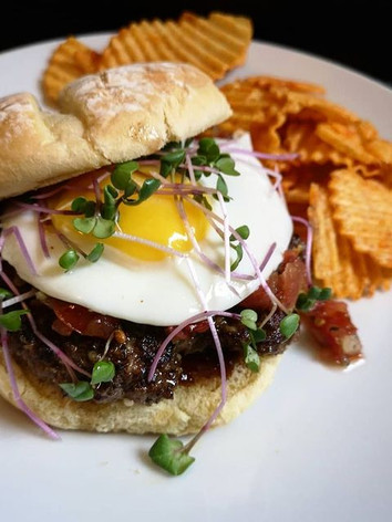 pegonaplate Made in Manitoba spicy smashed burger: Ground beef and onions were ordered from @diversityfoodservices and are sourced from Manitoba farms; topped with a @freshrootsfarmmb fried egg, @flora_and_farmer Fermented Salsa, and @fresh_forage microgreens. Served with @tomahawkpotatochips Fire Chips bought at @preserve_store. . Our local food community needs us more than ever. I still shop at box stores (the bun is Villagio bought at the Shoppers down my street) but I try to buy my staples from local shops and producers. I've gotten to know the growers, sellers, and makers of my food: Michelle & Troy from Fresh Roots Farm; Kim from Preserve Store / Flora & Farmer; Joel from @fresh_forage. Small businesses are not faceless corporations. They are run by real people with real bills and they have been hit hard by the COVID-19. . But many Manitoba businesses have persevered by adapting their practices to better serve their customers: @diversityfoodservices offers delivery of meals and groceries, including meat, produce, and dry goods; @preserve_store offers pre-ordered pick-up and delivery of @flora_and_farmer and other Manitoba makers; @fresh_forage offers free delivery and includes free samples; @freshrootsfarmmb has streamlined their egg-share and meat-share programs while offering an online store with monthly pick-up. . Please check out my highlights for groceries and products to find out how local businesses are striving to get food into your kitchens. Small businesses are the heart of our economy. It's up to us as consumers to keep that heart beating. . Eat local. Cook local. Support local. Support farmers.