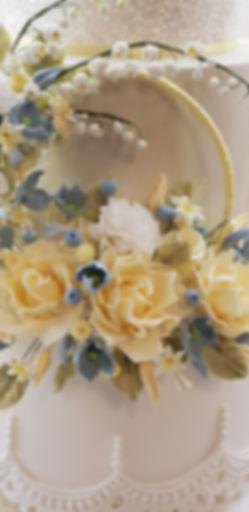 wedding cake with handmade sugarpaste flowers