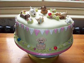 Dog's Birthday Party on a cake