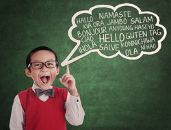 Education concept_ Asian school boy learns to speak different languages in a classroom
