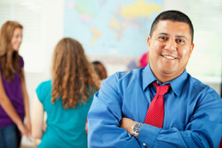 Classroom_ Smiling Hispanic Teacher With Arms Crossed
