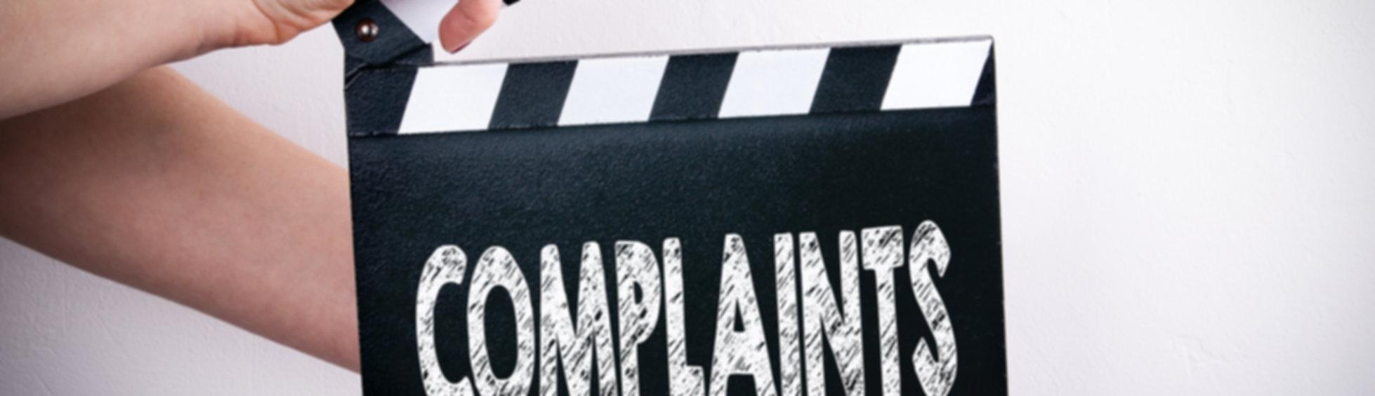Complaints. Female hands holding movie c