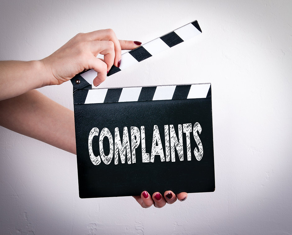 Complaints. Female hands holding movie c