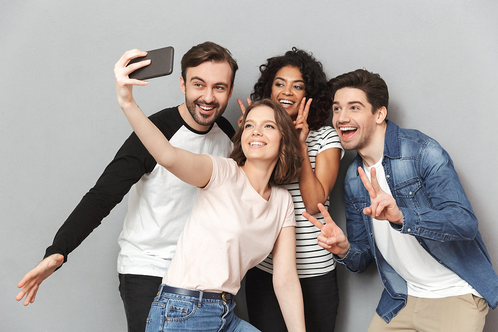 Photo of happy group of friends standing