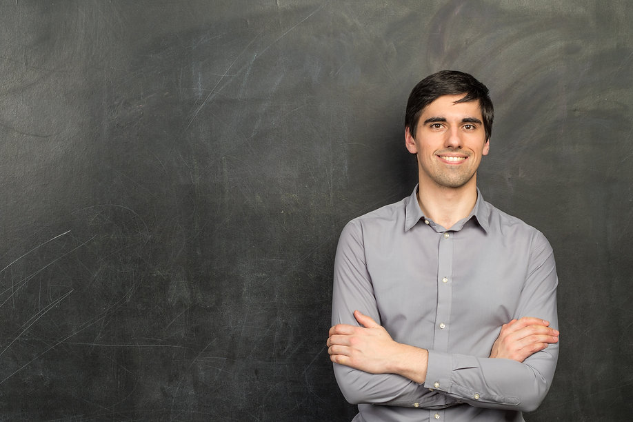 Portrait of young happy smiling teacher