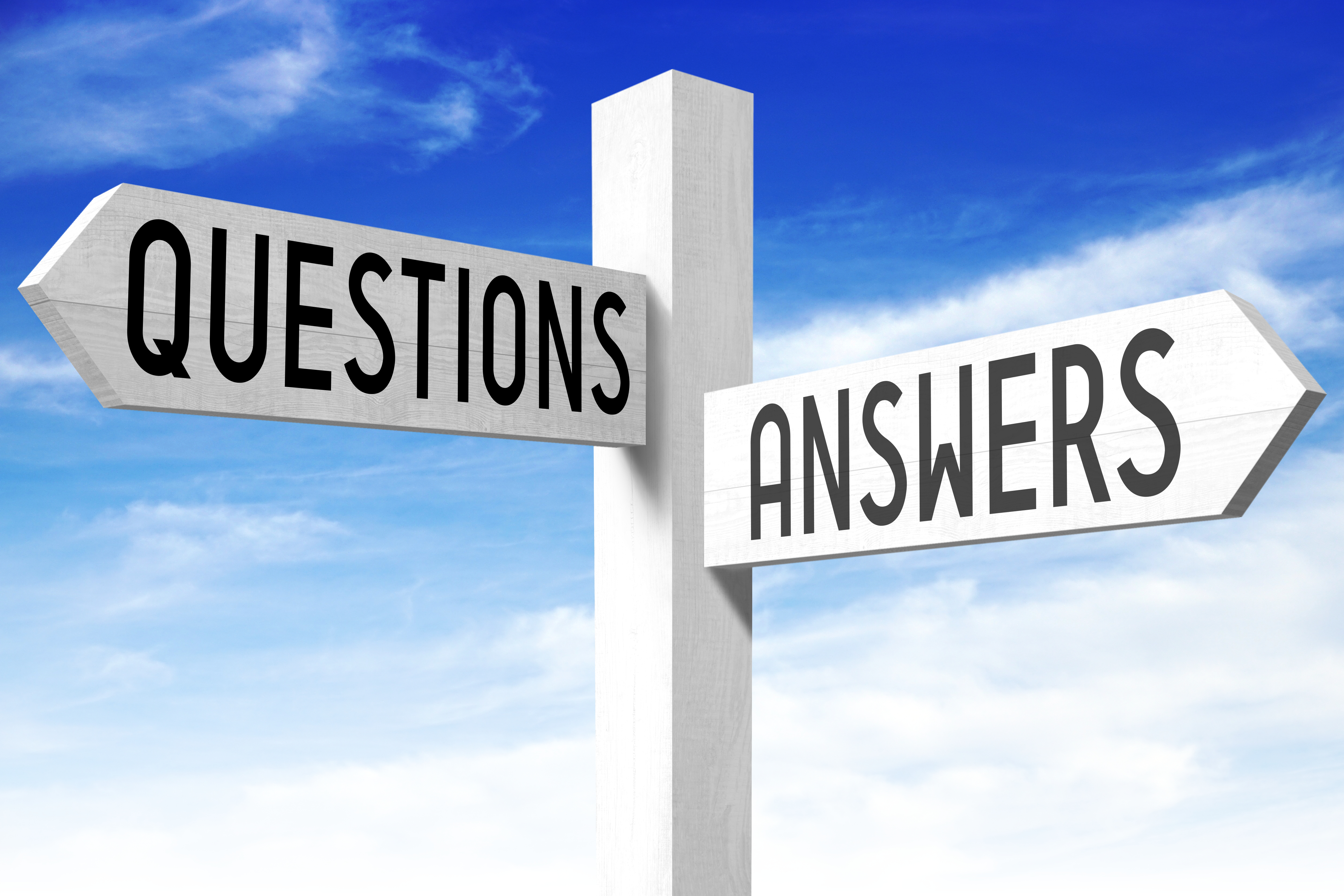 Questions, answers - wooden signpost
