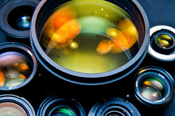 1200px-Photographic_lenses_front_view