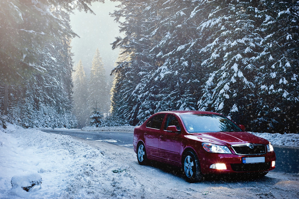 Red Car in Snowy Weather - Vancouver - BC Driving Tips