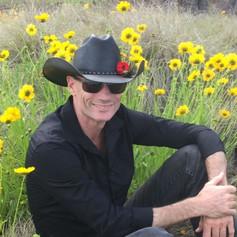 Robert Photo in Flowers.jpg