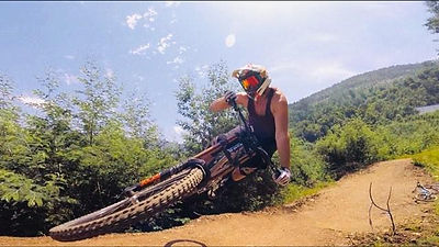 Brett Wheeler of Wheelers MTB Holidays laying it flat over moto sized jumps