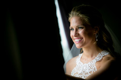 Bride Looking Out Curtains