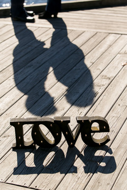 'Love' Sign with couple's shadow