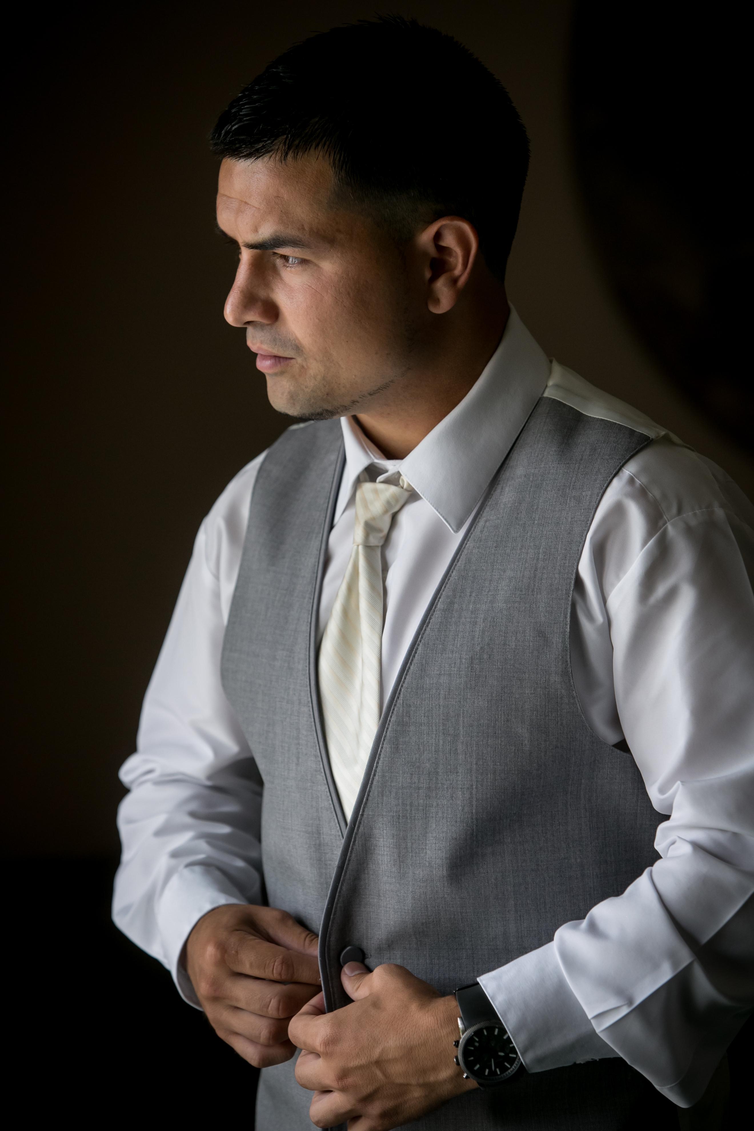 Groom Prep: Buttoning the Vest