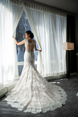 Getting Ready: Bride Looking Out Window