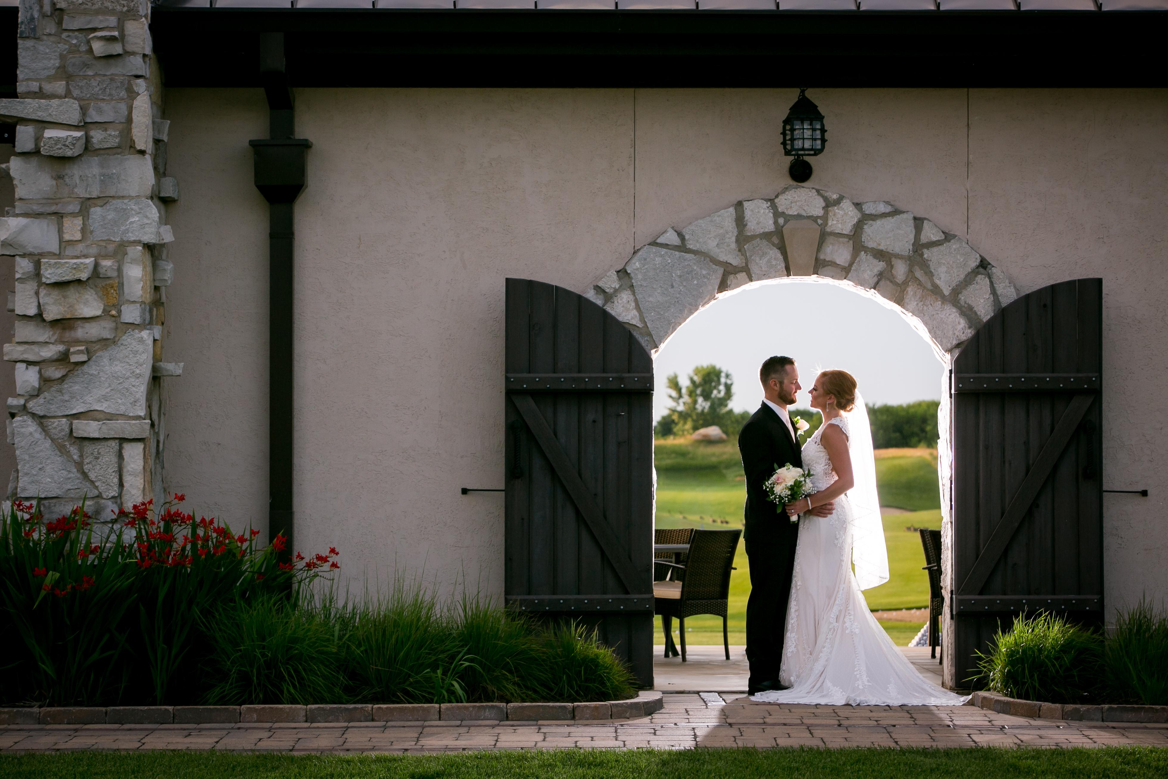 Wedding Couple Framed by Door