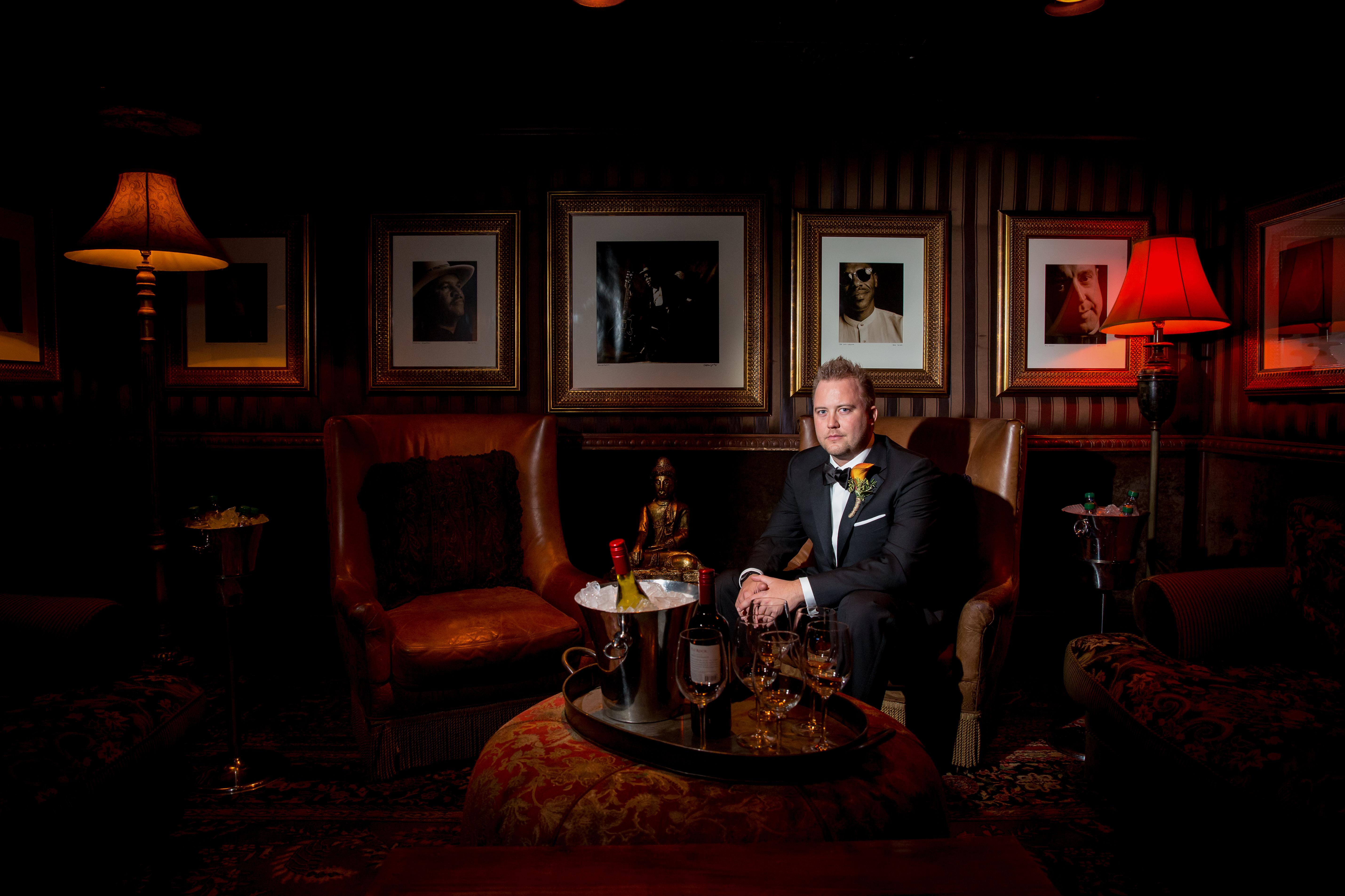 Groom Portrait: Lounge with Celebrity Photos