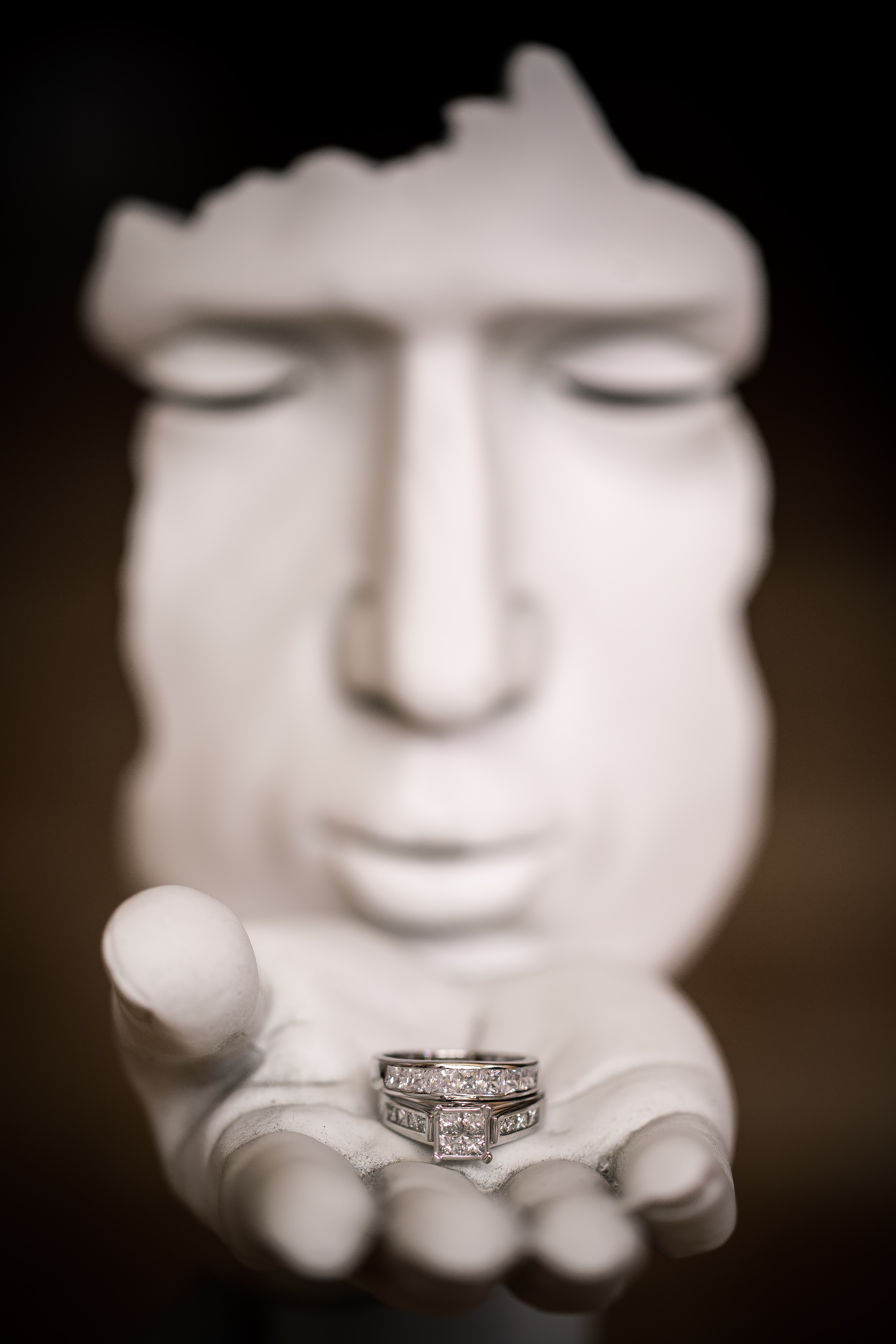 Wedding Ring on a Statue Blowing a Kiss