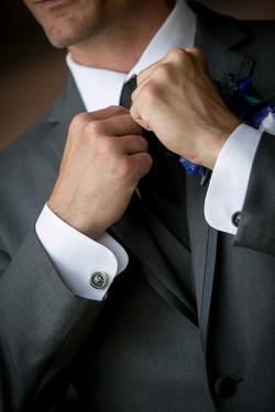 Groom Adjusts His Tie