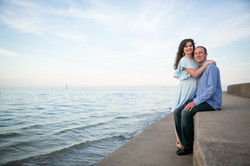 Couple embraces by Lake Michigan in Chicago