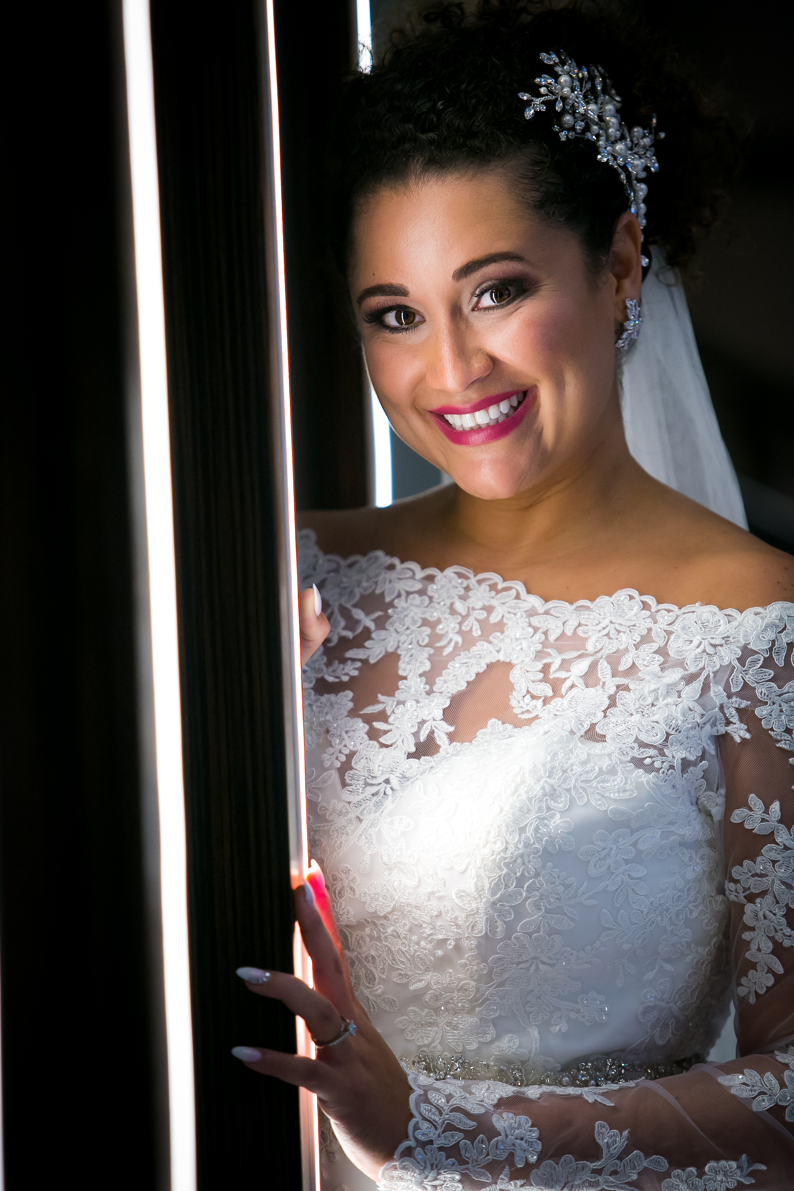 Bride by Lighted Wall