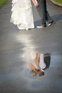 Bride and Grooms Kiss Captured in Reflection