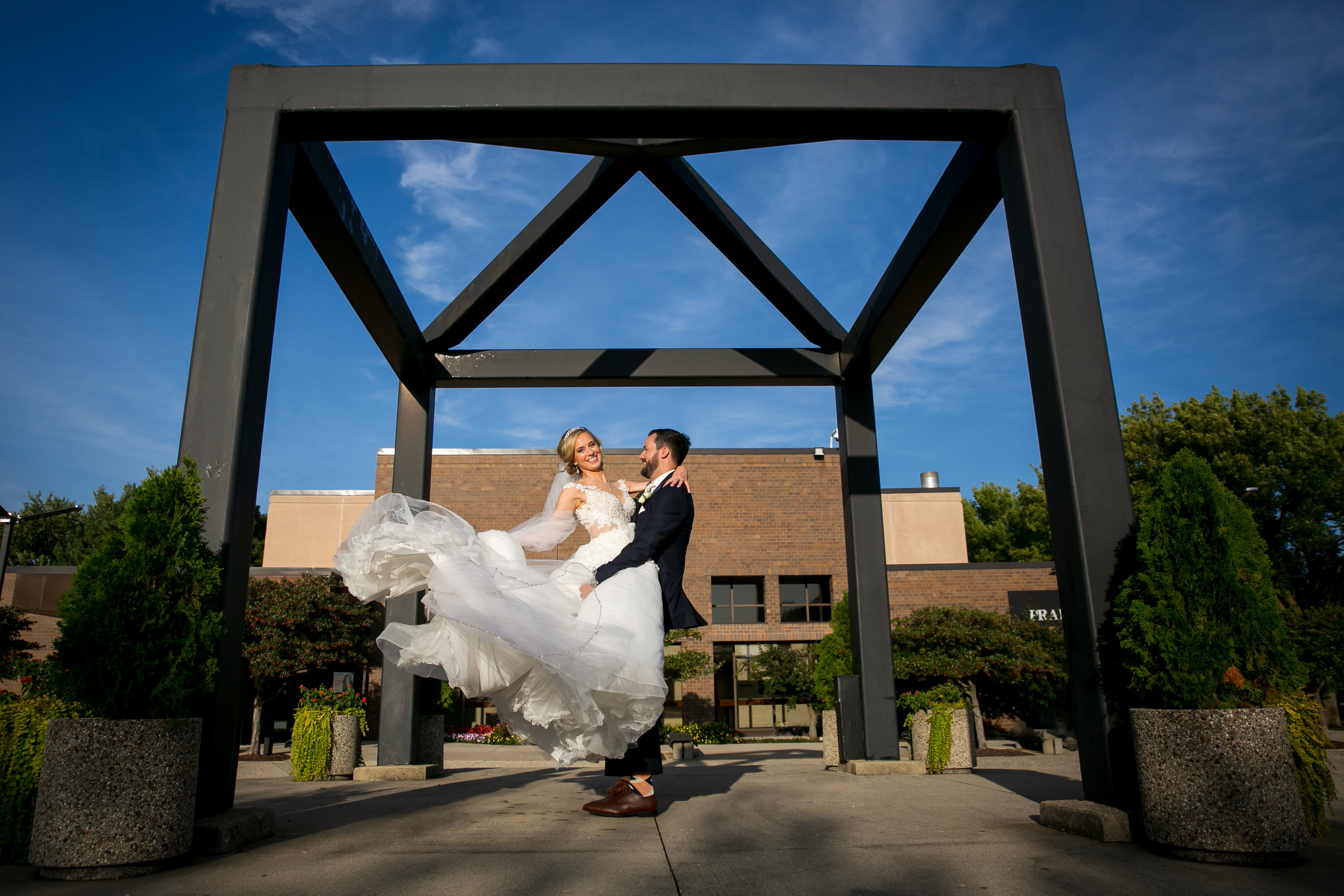 Groom Lifts and Twirls Bride