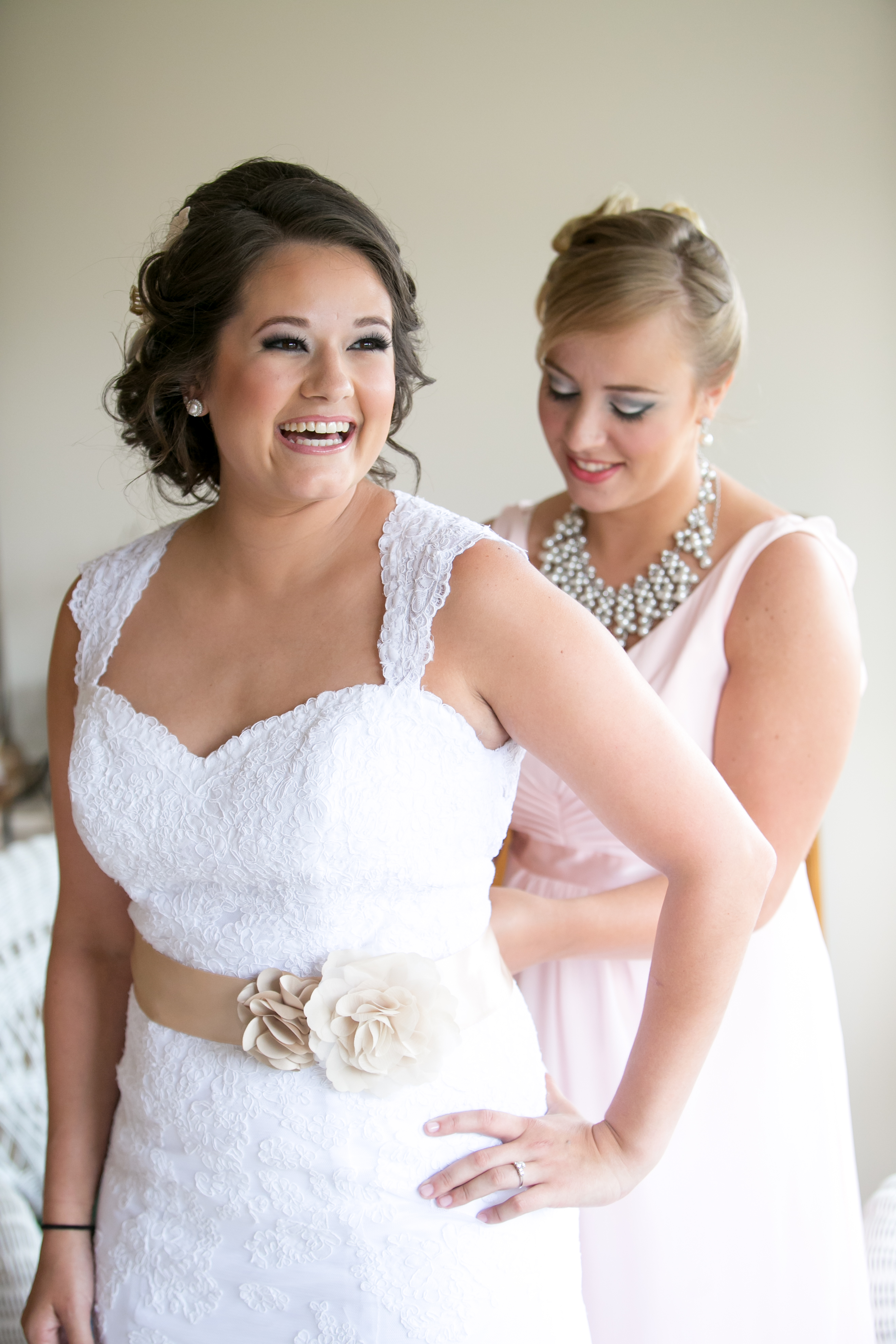 Bride Prep: Maid of Honor Doing up Brides Dress