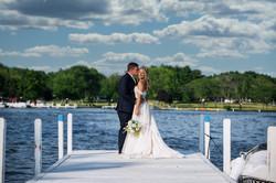 Couple Embraces on Dock