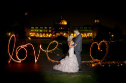 """""""Love"""" Sparkler Wedding Photo with Bride and Groom"""