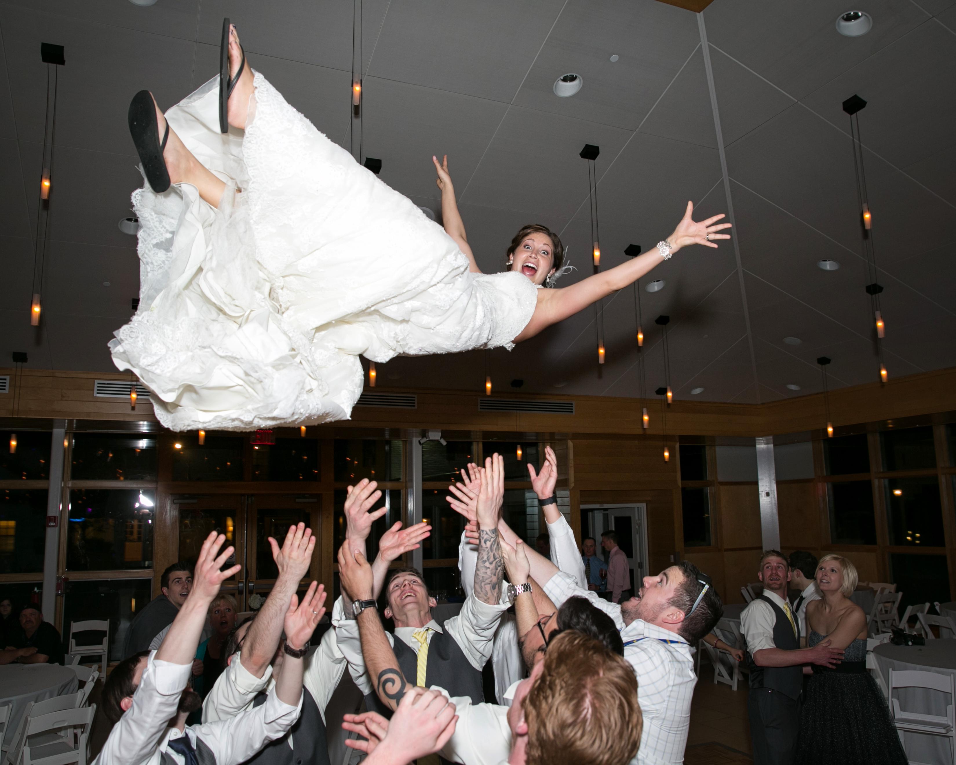 Groomsmen Toss Bride in the Air