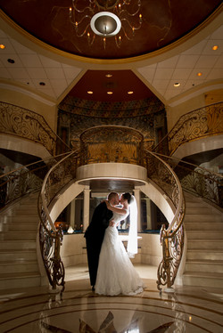 Cuple Dip Kiss in front of Stairway