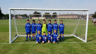 Lee Rangers Under 12 Whites ready for all weather conditions