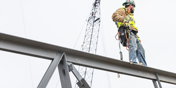 Man working at heights wearing harness