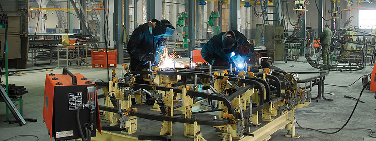 Welders welding in a workshop