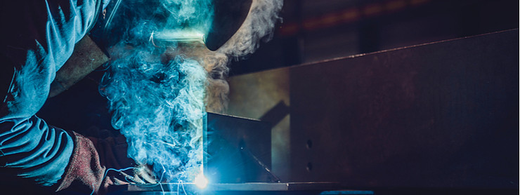 Welder welding with welding fume