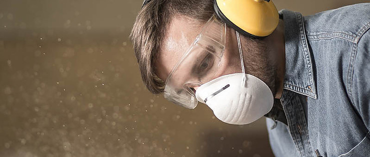 Worker wearing respiratory mask and PPE