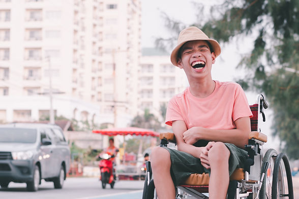 disabled-child-on-wheelchair-is-smiling-