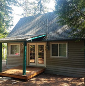 The original Millards cabin! Multi tone grey and off green pillars.  Cute in its own right...not quite what we wanted our guests to see when they pull in.