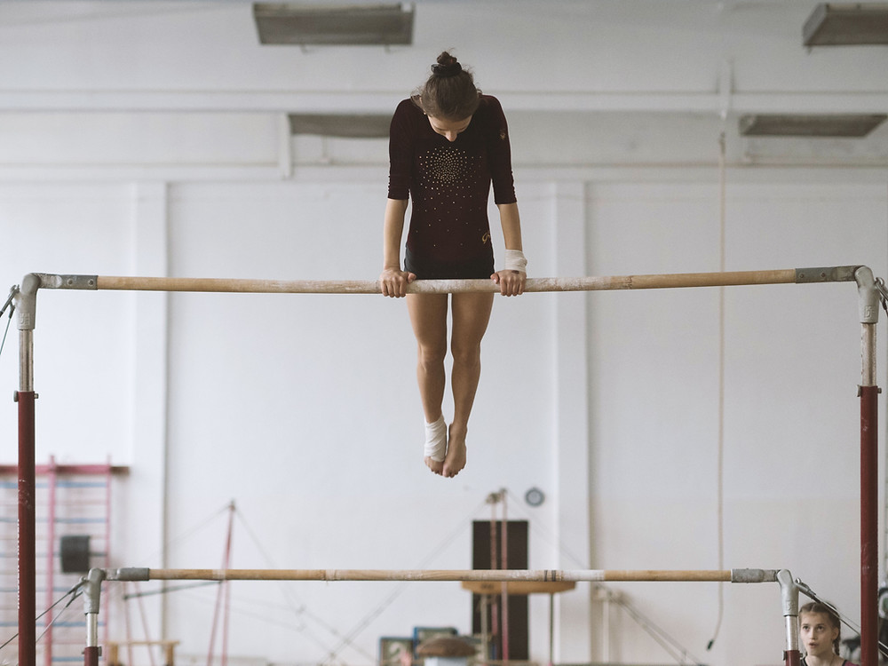 gymnast practicing bars. collections agency practice material.