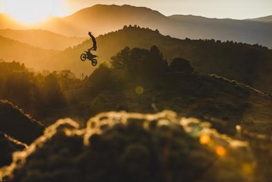 Motocross Photography | Professional freestyle motocross rider Adam Jones flies high against the setting sun