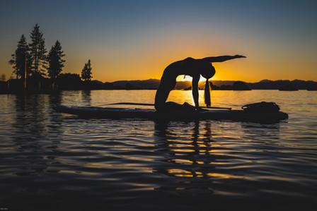 Yoga Photography: Paddleboarding at sunset on Lake Tahoe.