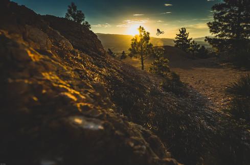 """Mountain Bike Photography: Freeride mountain biker, Damon Iwanga, flies high above """"The Biggest Little City."""""""