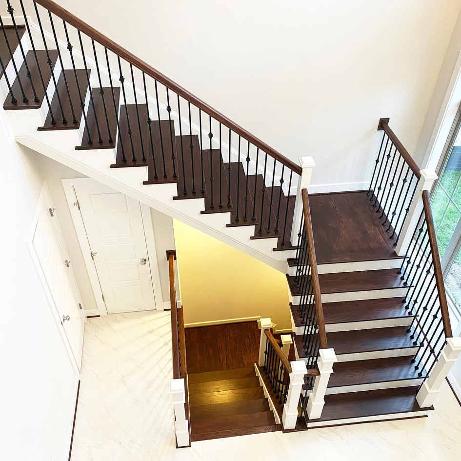 Brown stairs and rails