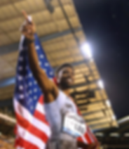 Noah Lyles with the United States flag after a running competition; photo courtesy of Noah Lyles, Nojo18 (Instagram)