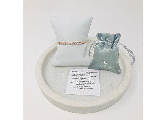 Lilly Co - Fine Rose Gold Pull Crystal Bracelet