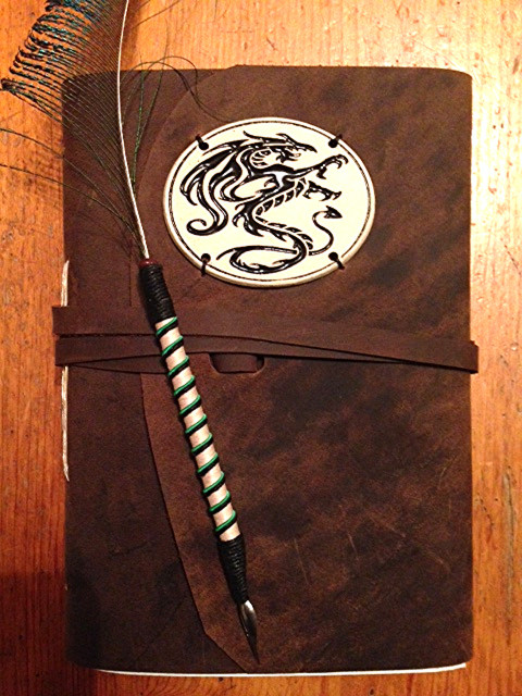 Leather journal and quill. There's a strong tie-in here to the finished product.