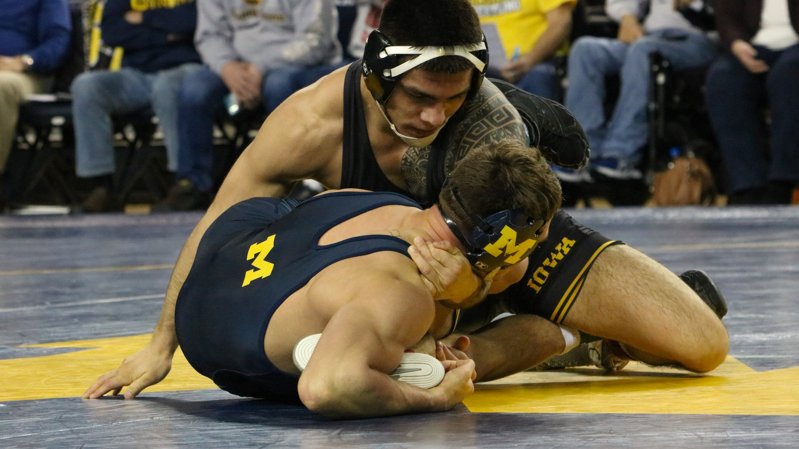 No.2 ranked Pat Lugo attempts to cradle No.9 ranked Kanen Storr of Michigan. Lugo won the match 2-0.